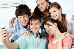 Five teenagers taking photo of themselves Stock Photos