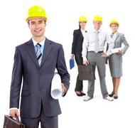 Collage of confident architects in helmets with their leader in front Stock Photos