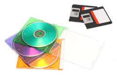 colored dvd and old floppy discs - stock photo