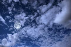 Night landscape with the moon, clouds and stars Stock Photos