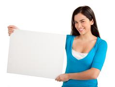 young woman holding a blank white sign - stock photo
