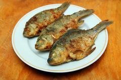 Fried fish crucian Stock Photos