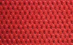 Red upholster material close-up Stock Photos