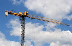 Lifting crane uder blue sky Stock Photos
