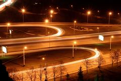 Traffic on night road junction Stock Photos