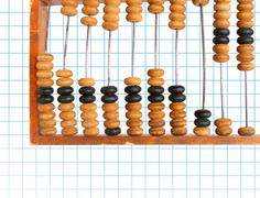 decrease diagram on abacus - stock photo