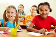 Stock Photo of portrait of lovely girls looking at camera at lesson