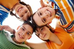 portrait of happy teens looking at camera with smiles - stock photo