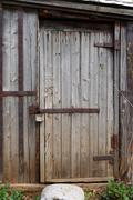 Closed wooden door of old shed Stock Photos