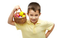 Photo of young boy with basket of easter eggs Stock Photos
