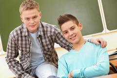 portrait of smart teenage guys looking at camera - stock photo