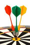 Dartboard with darts in aim Stock Photos