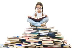 Portrait of cute girl with open book and looking at camera Stock Photos