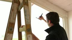 scraping window - stock footage