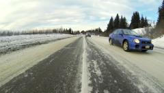 Sterling Highway in Winter - Approaching Homer, AK - low angle rear view POV. - stock footage