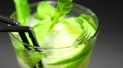 Mojito cocktail on black background rotation Stock Footage