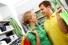 A young couple shopping together in supermarket Stock Photos