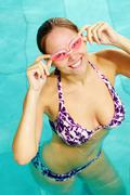 portrait of fresh female with goggles in water posing before camera - stock photo
