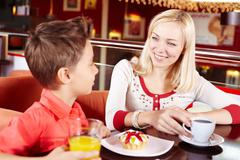 Portrait of cute lad and his mother in cafe Stock Photos