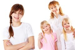 happy teenager looking at camera with her family on background - stock photo
