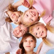 A young friendly family making circle while looking at camera Stock Photos