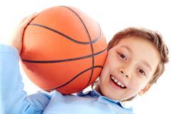 portrait of a boy holding a basketball ball - stock photo