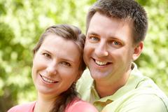 portrait of cheerful couple on summer vacation - stock photo