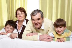 Portrait of grandparents with two their grandsons Stock Photos