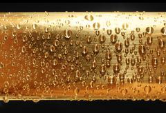 water drops on golden metal - stock photo