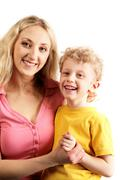 Portrait of happy mother and her son over white background Stock Photos