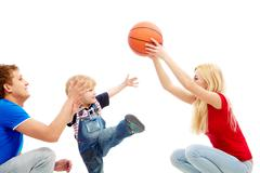 image of mom and dad playing with their son - stock photo