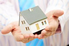 Close-up of toy house model in male hands Stock Photos
