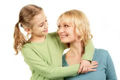 portrait of little girl and mother face to face - stock photo