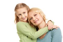 Portrait of little girl embracing woman wearing casual clothes Stock Photos