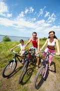 High angle view of family of three on bikes Stock Photos