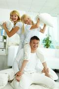 portrait of happy parents and their daughter having fun at home - stock photo
