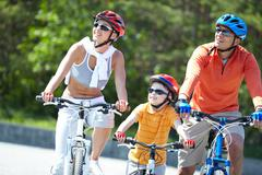Portrait of happy family riding on bicycles at leisure Stock Photos