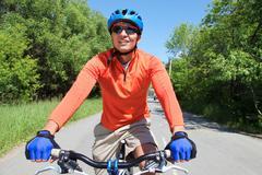Portrait of a handsome man riding a bike Stock Photos