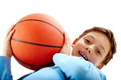 Portrait of a boy holding a basketball ball Stock Photos