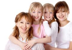 A young family of four looking at camera Stock Photos