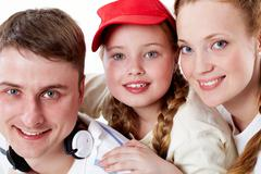 portrait of happy parents and their daughter looking at camera - stock photo