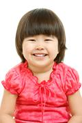 portrait of cute child laughing in isolation - stock photo