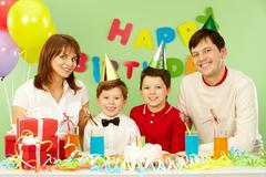 portrait of family celebrating birthday - stock photo
