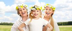 portrait of grandmother and mother behind for child with smile - stock photo