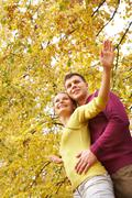 Happy couple embracing in autumn outdoors Stock Photos