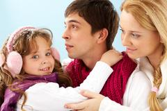 happy family members in winter clothes - stock photo