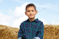 happy lad looking at camera in countryside - stock photo