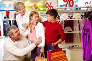 Portrait of happy grandparents and grandchildren in department store Stock Photos