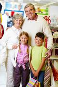 portrait of happy grandparents and grandchildren during shopping - stock photo
