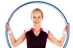 portrait of a smiling woman holding a hoop - stock photo